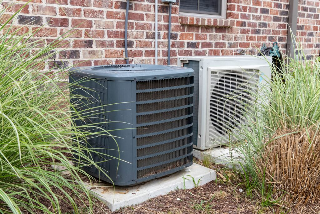 Regular home HVAC air conditioner system and mini split repair services next to each other Texas Air Repair